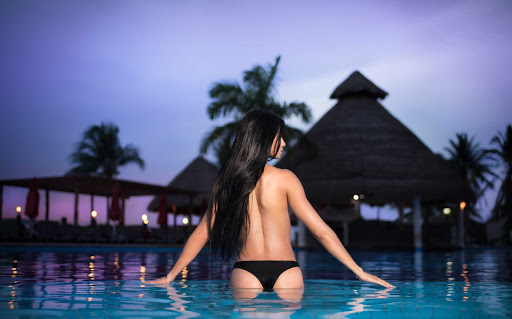 Some women go topless in the sexy pool, giving Temptation Cancun Resort a European/Mediterranean vibe.