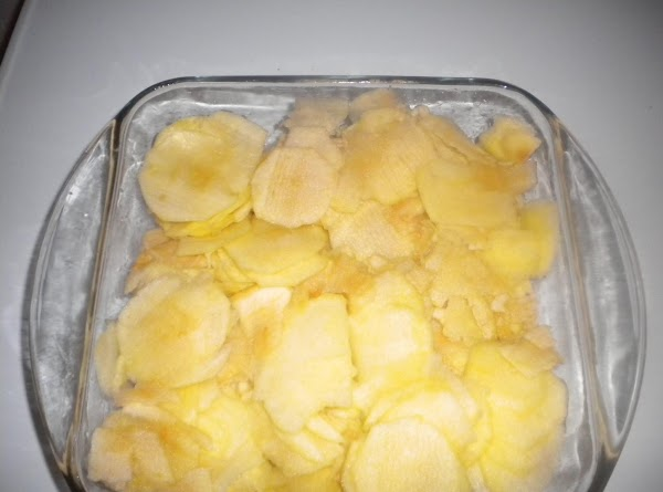 Peel apples and slice into a buttered baking dish 8x8 or 9x9.