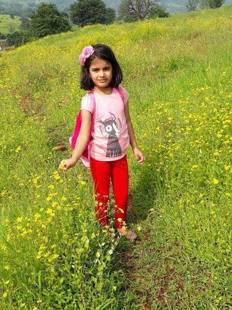 An angel amidst beautiful flowers @ Nisargshala