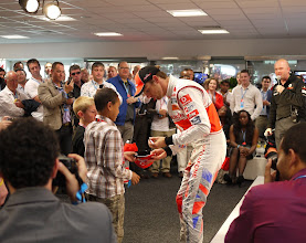 """Photo: Jenson Button is friendly to children. However, he told an adult """"no"""" when asked if he'd pose for a photo. True story."""