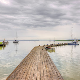 by Hartmut Ustorf - Landscapes Waterscapes ( cloudy, green seats, boats, jetty, water )