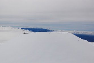 Photo: As we approach the summit area, Mauna Loa peeks over the top of the cone. You can see one of the snowboarders still inching up the side at right. He's just a speck.