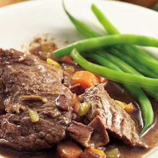 Slow-Cooker Beef Roast with Bacon-Chili Gravy.