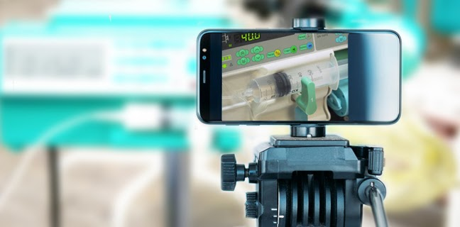 Smartphone recording video on a tripod