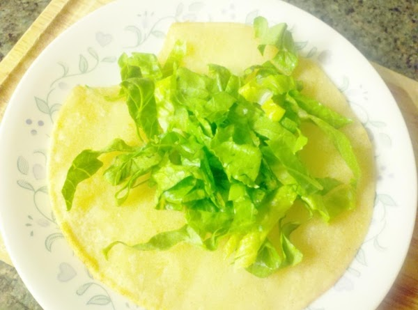 Assemble tacos.  On your tortilla, add lettuce.