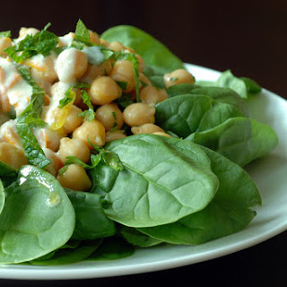 Chickpea and Spinach Salad with Cumin Dressing and Orange Yogurt Sauce.