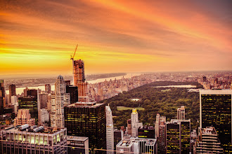 Photo: The New York City Skyline and Central Park from above during sunset  Summer evenings are when the city smolders  as the sun paints the clouds  and the night sky waits just another hour longer  to dance with the last remnants of the day.   —-   This is a view of the skyscrapers of midtown Manhattan and Central Park from above looking north towards upper Manhattan. I took this at the end of August on a gorgeous, sweltering evening. I made it up to the top deck of Top of the Rock (30 Rock) just as this spectacular sunset was making its way across the sky.  It's hard not to feel overcome with emotion when the summer sky puts on one of its late summer sunset shows. When it happens, the city is bathed in an other-worldly glow as the lights in the buildings twinkle on like stars and the sky and the impossible all seem to melt away into an infinite horizon full of endless possibility.    You can view this post along with all relevant links over at my photography blog if you wish here:  http://nythroughthelens.com/post/44328134558/the-new-york-city-skyline-and-central-park-from    Tags: #photography  #newyorkcity  #nyc  #nycphotography  #newyorkcityphotography  #newyorkphoto  #centralparkphoto  #architecture  #landscape  #cityscape  #newyorkcityskyline  #nycskyline  #manhattanskyline  #city  #skyscrapers  #nycfromabove  #saturdayinspiration