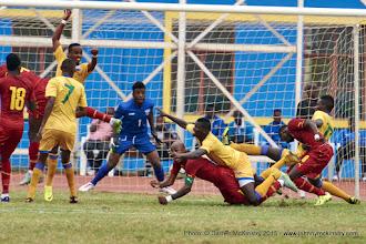 Photo: Olivier KWIZERA (goal) ready in anticipation as players scramble for the ball [Rwanda Vs Ghana AFCON2017 Qualifier, 5 Sep 2015 in Kigali, Rwanda.  Photo © Darren McKinstry 2015