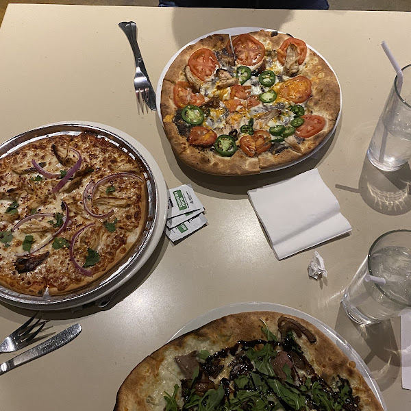 GF pizza (left) has its own tin that it's baked on