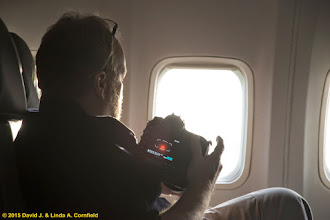 Photo: David checks his exposures during the partial phase of the total solar eclipse of 20 March 2015. We flew on the Icelandair 757 named Snæfellsjökull.