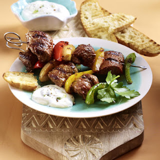 Beef Skewers with Toasted Pita Bread.