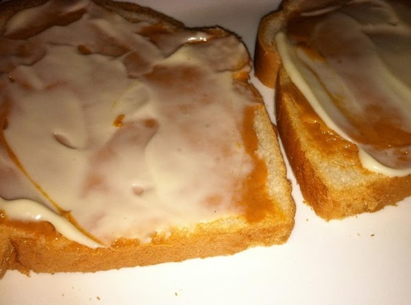 Bread with spread peanut butter and spread mayonnaise.