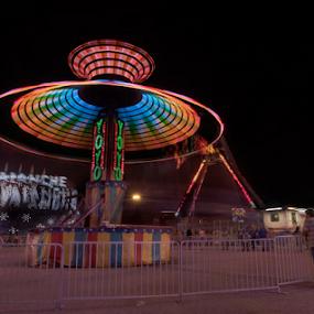 Yo-Yo by Amitabh Mukherjee - City,  Street & Park  Street Scenes ( exposure, moon, carnival, full', colorful, houston, texas, wide, blur, long, fair, color, carousel, motion )