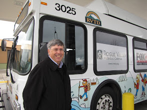 Photo: Medford City Council Member Al Densmore next to a CNG bus, one of 15 in the RVTD fleet.