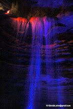 Photo: Colored lights highlight the lowest level waterfall.