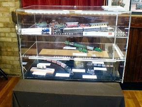 Photo: 002 The Sussex Downs Group display case with superb models by SDG Members (bottom shelf) Martin Collins, (middle shelf) Simon Wilson and top shelf: Tim Sanderson and guest Ted Polet .