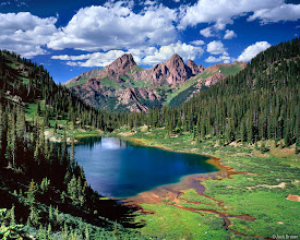 """Photo: Pigeon and Turret Peaks, of the <a href=""""search.php?q=needle%20mountains"""">Needle Mountains</a>, tower above this remote alpine lake in the San Juan Mountains - July"""