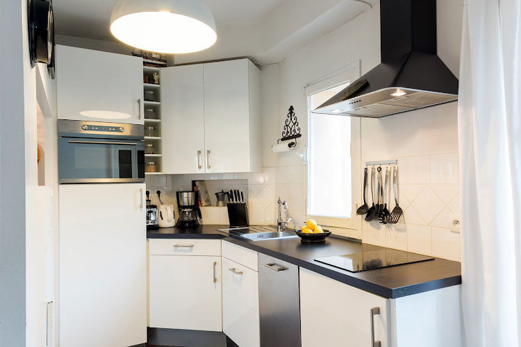 Fully equipped kitchen at Stylish Marais near beautiful Square du Temple