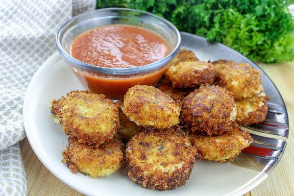 A Plate Of Fried Cheese With Marinara For Dipping.