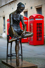 Photo: The Ballerina of Covent Garden with Iconic Red Phone Boxes - London, U.K.  Perhaps one of my favorite statues in London is The Ballerina. You can find this lifesize bronze statue in Broad court, opposite the Opera House in Covent Garden. She is the creation of Italian artist Enzo Mario Plazzotta and modelled after ballerina dame Ninnette De Valois. Irish-born dame Ninnette de Valois, whose real name is Edris Stannus came to London and founded a ballet academy and one of the first ballet companies of the 20th century. Having contributed a lot to the history of English ballet, she is regarded as the godmother of ballet and was named Life Governor of the Royal Ballet after she retired in 1964.  Of course, another British icon can be seen behind her in this photograph - the red phone boxes.  #TheBallerina   #London   #CoventGarden   #England   #UK   #Travel   #Photography   © Yen Baet - www.YenBaet.com. All Rights Reserved. Join me on Facebook at www.facebook.com/YenBaetPhotography.