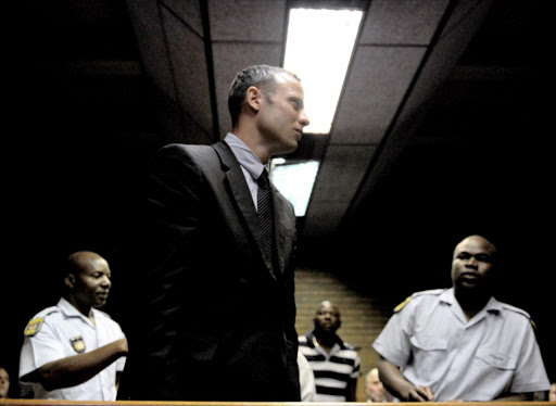 Oscar Pistorius leaves the court room after his hearing on charge of murdering his model girlfriend Reeva Steenkamp. File photo.