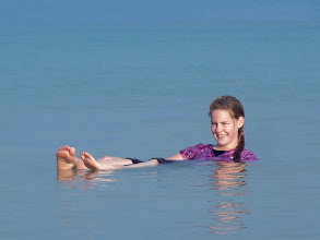 Photo: Floating in the Dead Sea is an interesting experience! The water (if you can imagine this) is about one-third salt! Because salt is heavier than water, this gives you an increased level of buoyancy, and you can easily float without treading water.