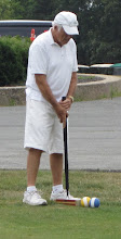 Photo: July 14, 2012 - Lewis lines up for a croquet shot.