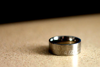 Photo: Requirement 1,5:  There's always a need for courage. Didn't have a macro lens so took with a nifty-50 and had to crop afterwards. Increased contrast to bring out the lettering on the ring