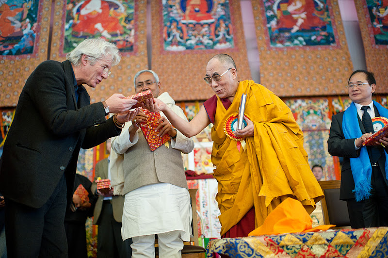 "Photo: His Holiness the Dalai Lama presents Actor Richard Gere, Chief Minister of Bihar Nitish Kumar, and Chief Minister of Arananuchal Pradesh Nabam Tuki copies of his book ""Beyond Religion"" to mark it's release in India on the last day of the Kalachakra for World Peace in Bodh Gaya, India, on January 10, 2012. Photo/Tenzin Choejor/OHHDL"