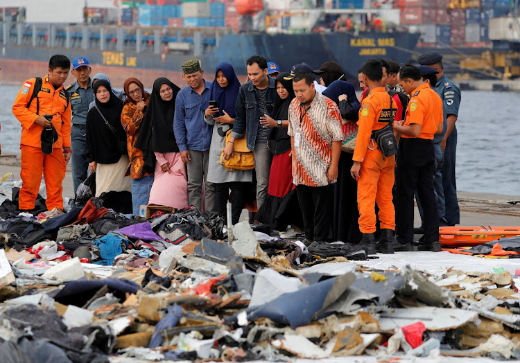 Families of passengers of Lion Air flight JT610 stand as they look at the belongings of the passengers at Tanjung Priok port in Jakarta, Indonesia, on October 31 2018. Picture: REUTERS/BEAWIHARTA