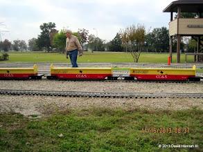 Photo: Train Master Bob Barnett getting the cars ready.    2013-1116 DH3