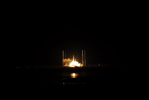 The SpaceX Falcon 9 rocket lifts off Space Launch Complex-40 carrying the Dragon capsule to orbit.