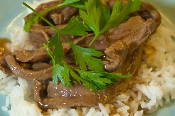 Add some rice, or noodles to a plate, place some beef slices on top,...