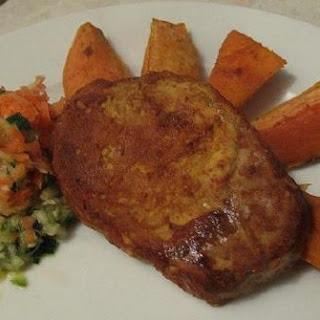 Tikka Pork Chop with Sweet Potato Wedges.