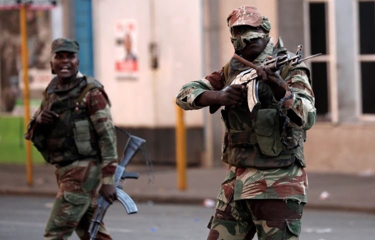 Soldiers open fire to disperse crowds of the opposition Movement for Democratic Change supporters outside the party's headquarters in Harare, Zimbabwe, August 1, 2018.