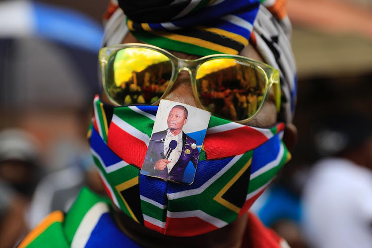 This supporter of self-proclaimed prophet Shepherd Bushiri went to town as followers gathered outside the Pretoria magistrate's court on November 4 2020.