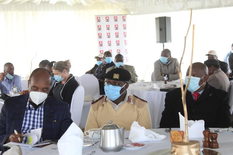 Nyandarua Governor Francis Kimemia, Nyeri deputy county commissioner Joseph Mwangi and Governor Mutahi Kahiga at Kiganjo in Nyeri on Friday