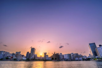 Photo: A beautiful sunset over Tokyo, Japan as seen from Tsukishima in Tokyo Bay