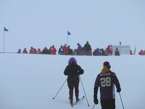 Photo: A few stragglers approaching the starting line, Pole sign to the right.
