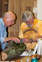 Photo: Ed Karch uses his new digital microscope to scope out that burled log brought in by Bill Long.