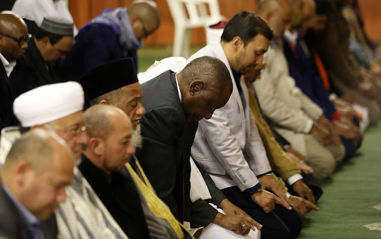 President Cyril Ramaphosa performs prayer with Muslim leaders during the Muslim Judicial Council of South Africa and the Muslim community Iftar dinner in Rylands, Cape Town.