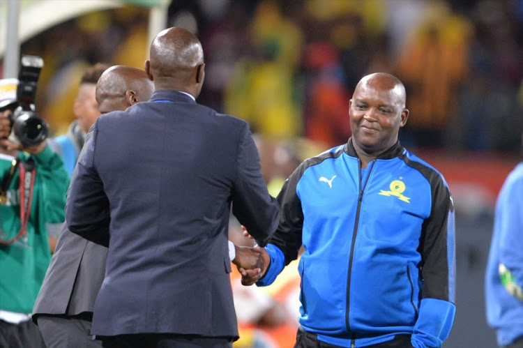 Mamelodi Sundowns' head coach Pitso Mosimane shakes hands with his Kaizer Chiefs counterpart Steve Komphela after the Absa Premiership match at Loftus Versfeld on October 17, 2017 in Pretoria, South Africa. Chiefs won 2-1.