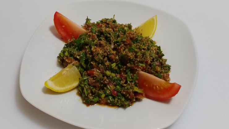 Tabouli - Salad made with fresh Parsley, Bulgur, Tomatoes, Onion, Spices, Olive oil, lemon juice  (Vegan, contains Gluten)