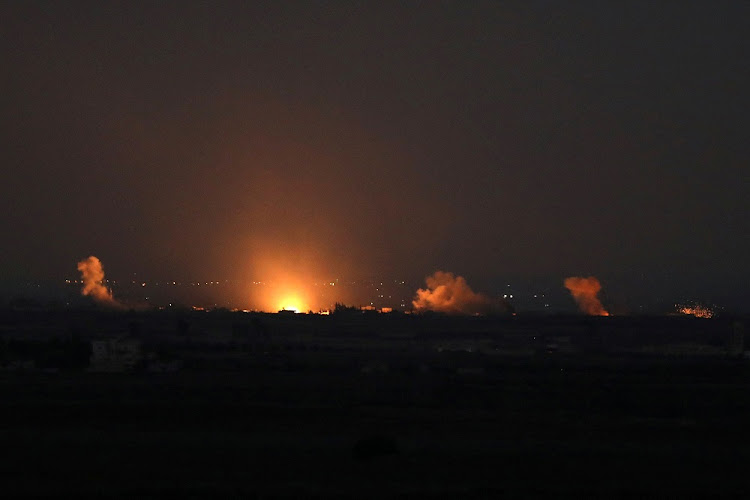 Fire follows an explosion at the Syrian side of the Israeli Syrian border as it is seen from the Israeli-occupied Golan Heights, Israel, July 26 2018. Picture: REUTERS/AMMAR AWAD