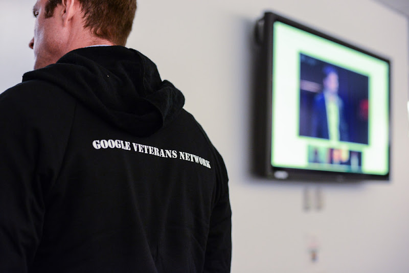 Photo: A Google veteran looks on as a the Wounded Warriors: Transitioning to the Civilian Workplace Google+ Hangout on Air is broadcast live to the  world. The background monitor captures the Hangout in progress. -- The Google Veterans Network is the military veteran community at Google for all those who are supporting the veteran community. (Wounded Warriors: Transitioning to the Civilian Workplace | November 8, 2012)