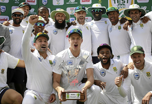 Last hurrah: Morné Morkel, centre with trophy, celebrates SA's series triumph over Australia at the Wanderers on Tuesday. It was Morkel's last international match before retiring. Picture: SIPHIWE SIBEKO/REUTERS