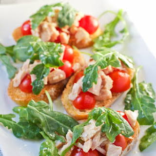 Puglia inspired Tuna Toasts with Tomatoes and Arugula.