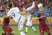 Los Angeles Galaxy forward Zlatan Ibrahimovic (9) scores a goal during the first half against Toronto FC at BMO Field.