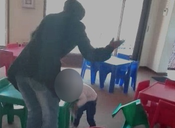 A video of a child being hit by a teacher because she vomited has caused outrage on social media.