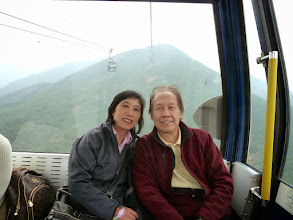 Photo: Remus & Jenny riding in the Ngong Ping 360 cable car in Lantau Island